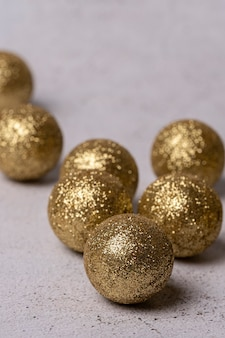 Close-up of gold-coloured christmas balls