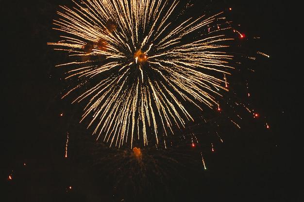 Close-up gold festive fireworks on a black