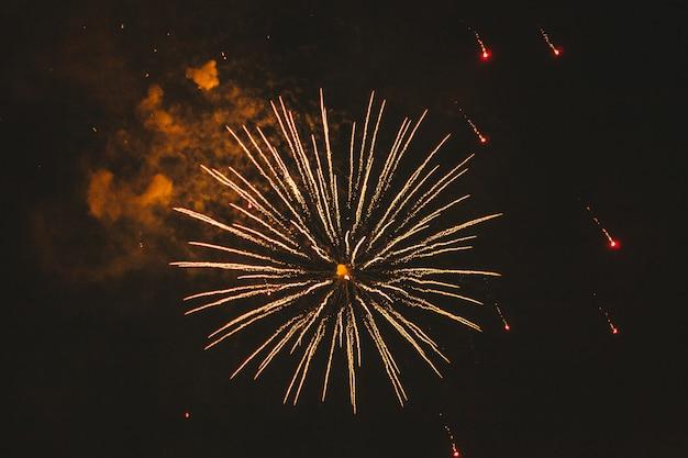 Close-up gold festive fireworks on black