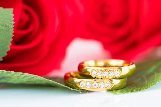 Close up gold ring and red roses