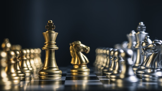 Close-up of gold and silver team chess board game
