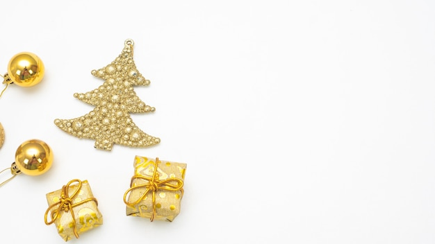 Close up golden christmas accessories on white background top view copy space