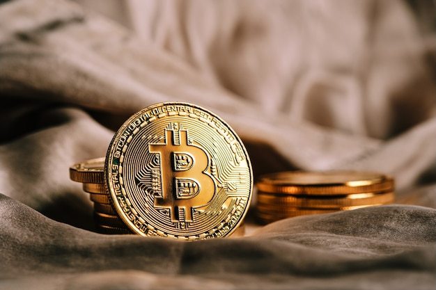 Close-up of golden cryptocurrency bitcoin and unfocused background