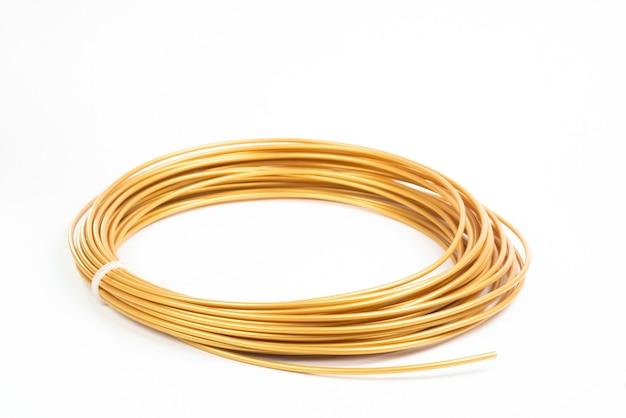 Close up golden roll filament for 3d pen