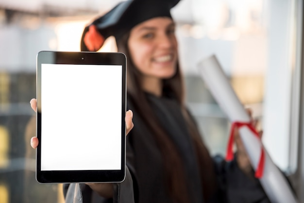 Close-up graduate with tablet mock-up