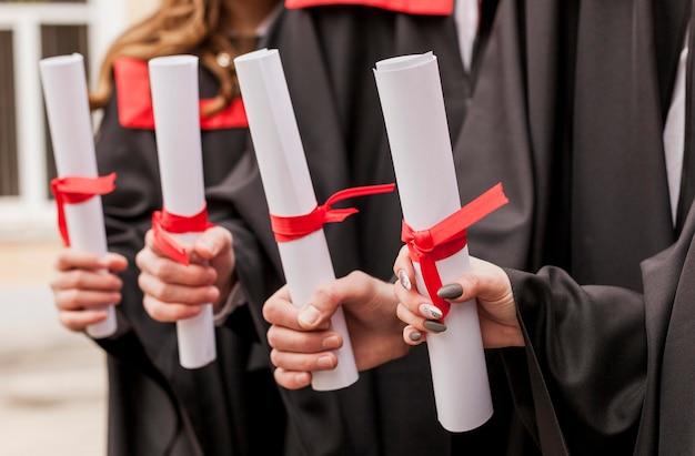 Close-up graduation diploms