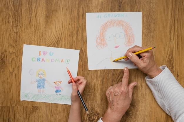 Close up grandparent and kid drawing