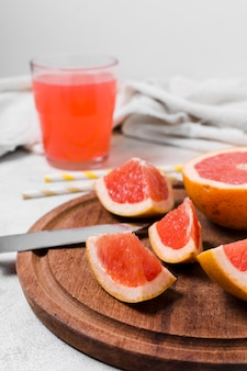 Close-up of grapefruit slices with juice