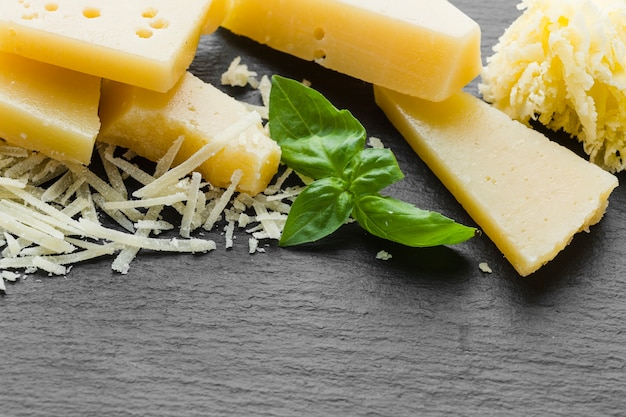 Close-up grated parmesan on table Free Photo