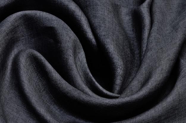Закройте вверх серого скомканного льняного текстурированного фона.