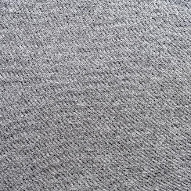 Закройте серый текстуры ткани и фон с пространством.