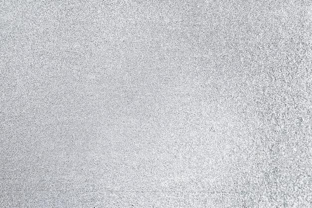 Primo piano di sfondo con texture glitter grigio
