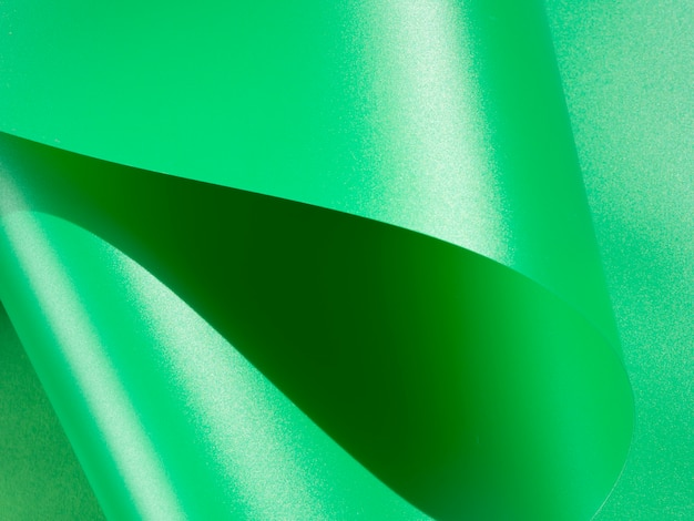 Close-up green abstract curved monochrome paper