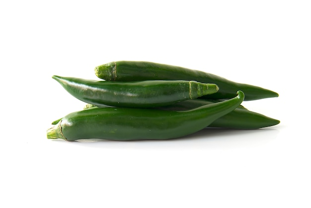 Close up green chili pepper isolated on a white background