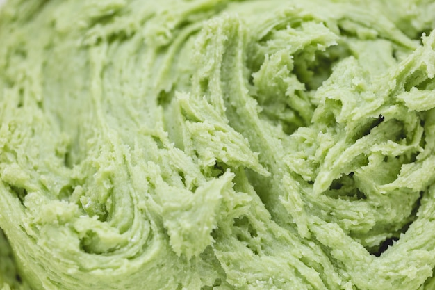 Close up on green cookie dough baking concept