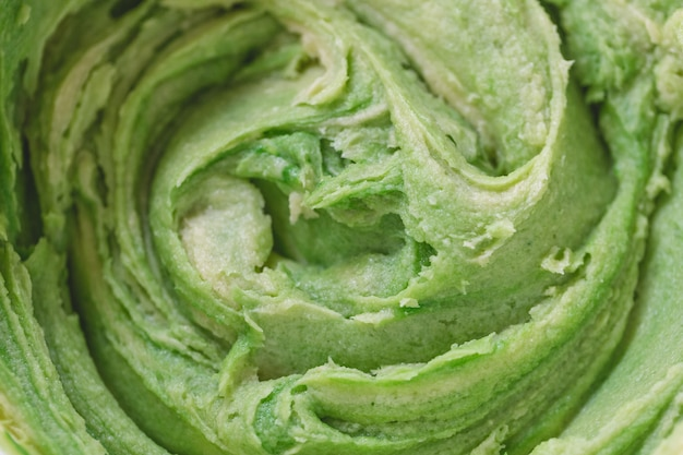 Close up on green cookie dough. spring holidays cooking concept.