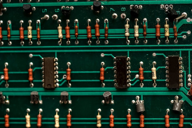 Close up of green electronic circuit board.