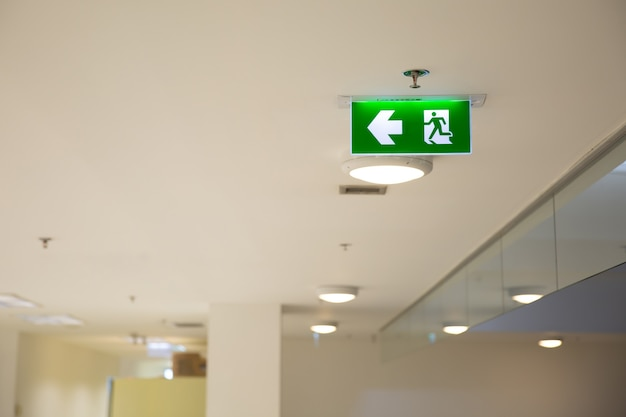 Close up the green fire exit sign.