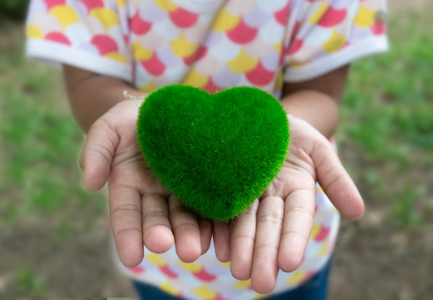 Close up of a green heart on little hand of child