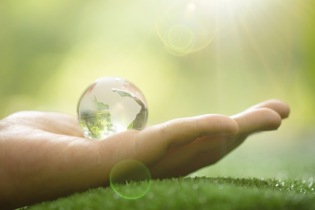 Close up of green planet in your hands. save earth.