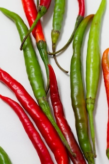 Close-up green and red chili peppers