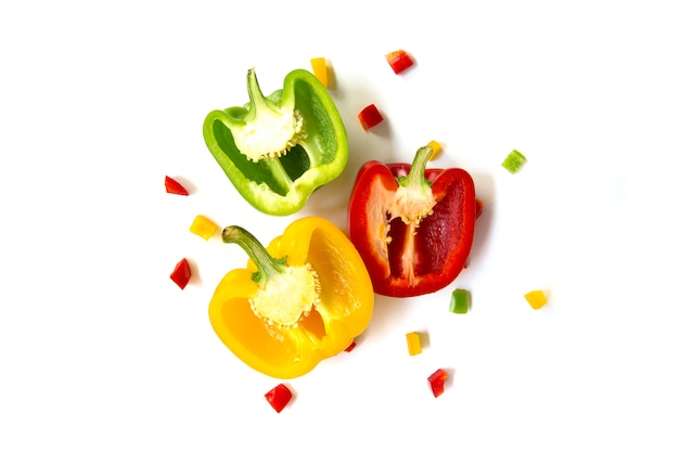 Close up green and red yellow bell peppers isolated on white background