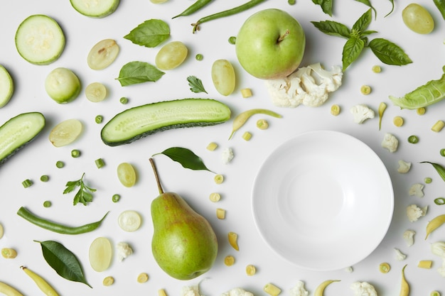 Close up of green vegetables and fruits for white table. healthy eating and food for vegans