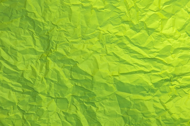 Close up of green wrinkle crumpled old with paper page texture rough background.