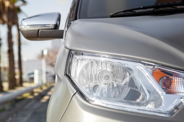 Close up of a grey electric car sport and modern design under the sun light