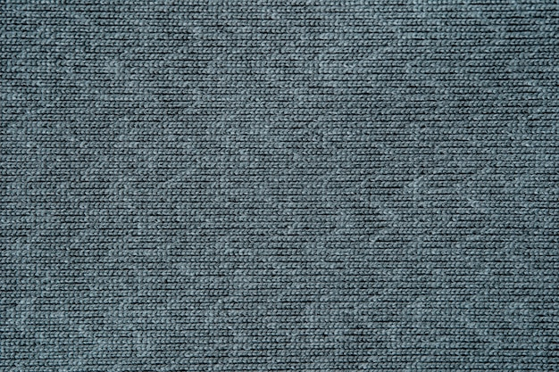 Закройте вверх по серой предпосылке текстуры ткани. для графического и художественного дизайна.