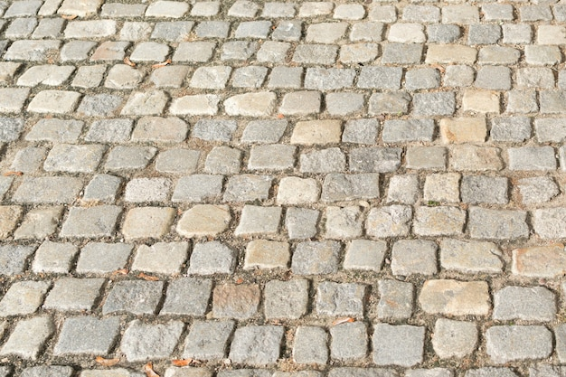 Close up on grey old pavement with big stones