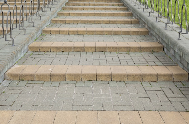 Close-up of grey street tiled steps going up