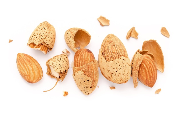Close up group of almonds nut with shell  and cracked almonds shell isolated on white background.