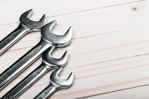 Close up of group of carpentry hand tools on wooden background