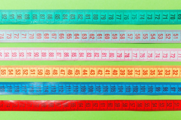 Close up of a group of colorful measure tapes