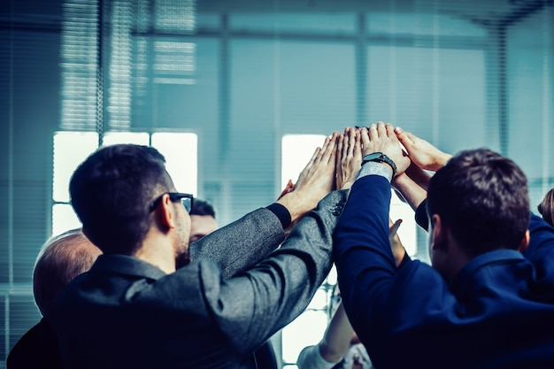 Close up. a group of corporate employees showing their unity. the concept of teamwork