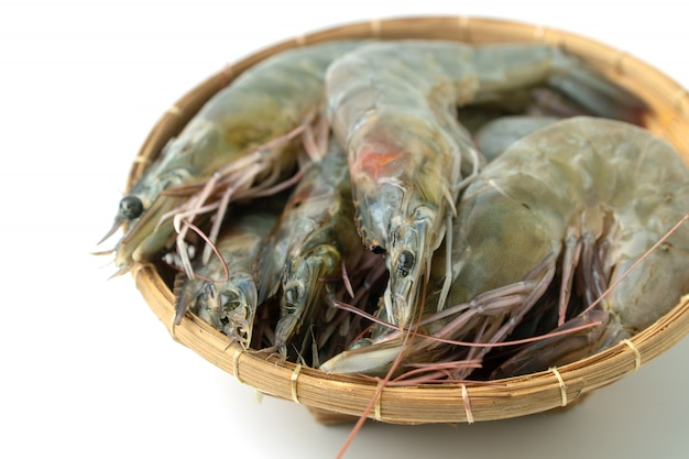 Close up group of fresh raw pacific white shrimp in bamboo bowl