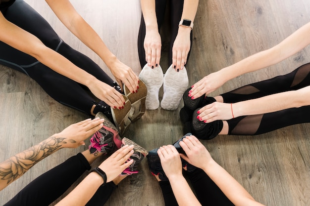 Close-up group of women stretching together