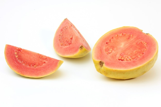 Close-up guava fruit, pink, fresh, organic, with leaves, whole and sliced, isolated on white background. front view