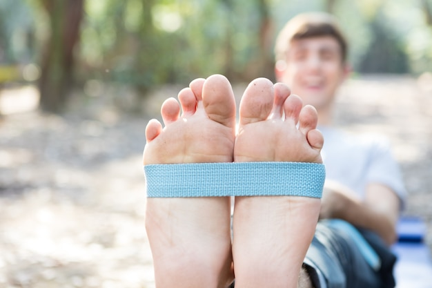 Close-up of guy's feet doing stretches