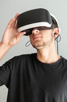 Close-up guy wearing virtual reality glasses