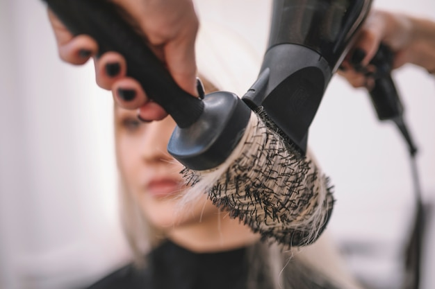 Close-up of hair styling with brush