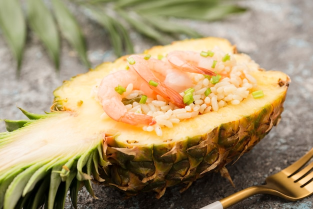 Close-up half of pineapple with shrimps