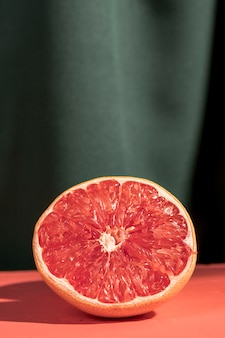 Close up halved grapefruit on table