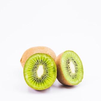Close-up of a halved kiwi fruits on white background
