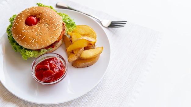Close-up hamburger with fries