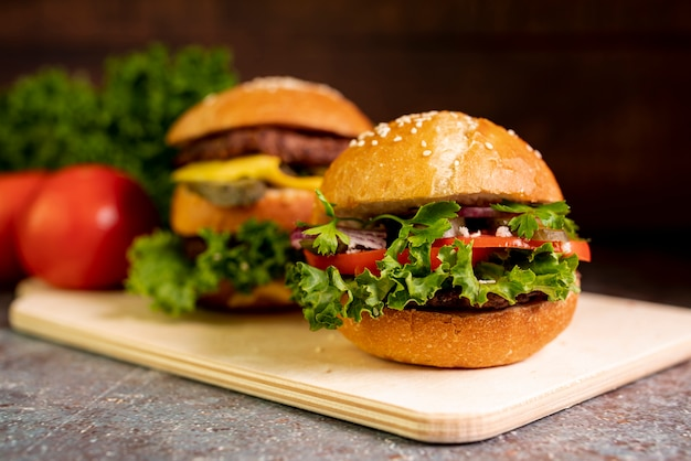 Close-up hamburgers on cutting board