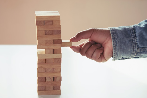 Close up of hand businessman playing block wood