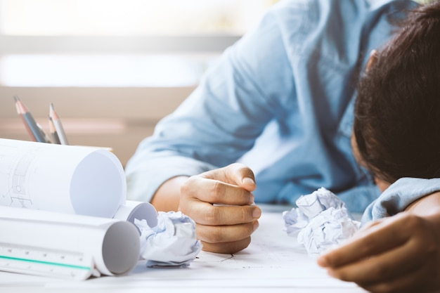 Close-up of hand businessperson having a nap at her desk with her head lying on her arm