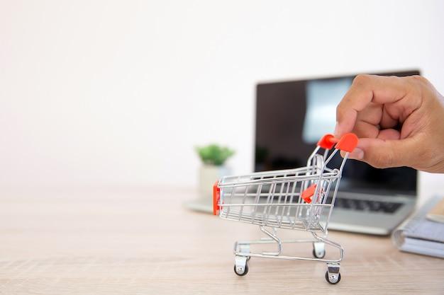 Close up hand choose the shopping cart.